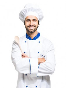 Cheerful chef isolated on white